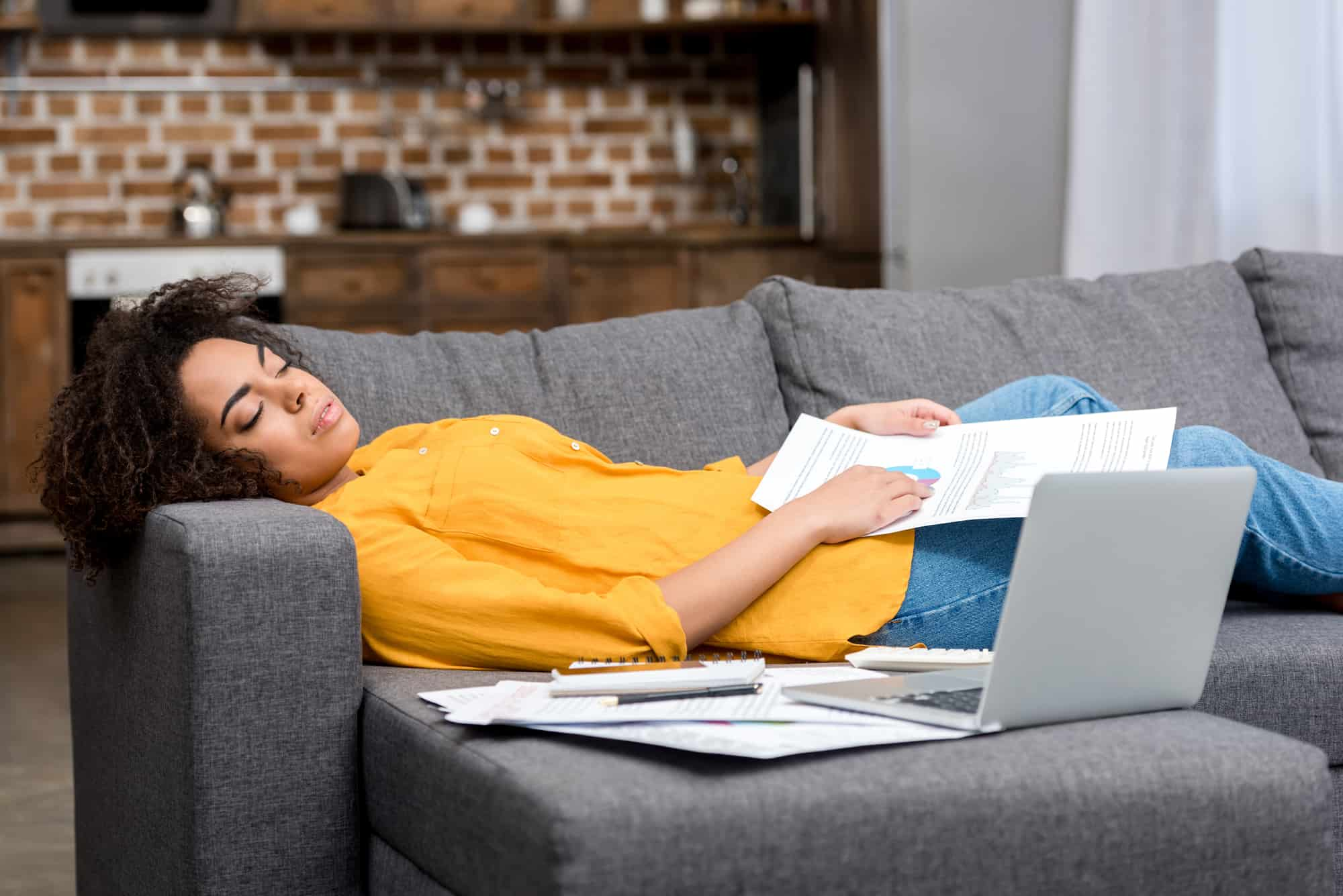 image of person on couch overwhelmed and unmotivated